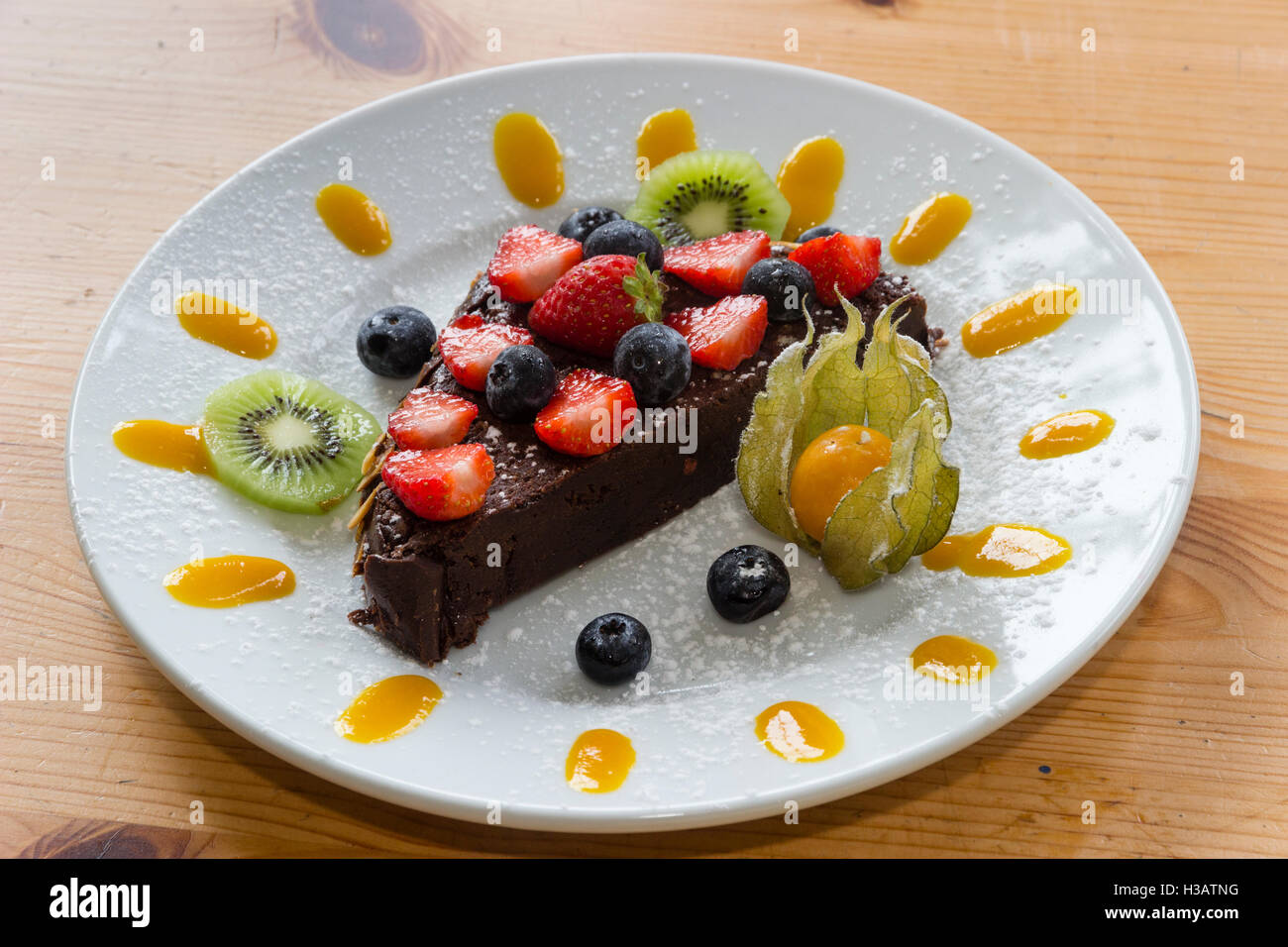 death-by-garden-house-rich-chocolate-cake-decorated-with-fruit-and-H3ATNG.jpg