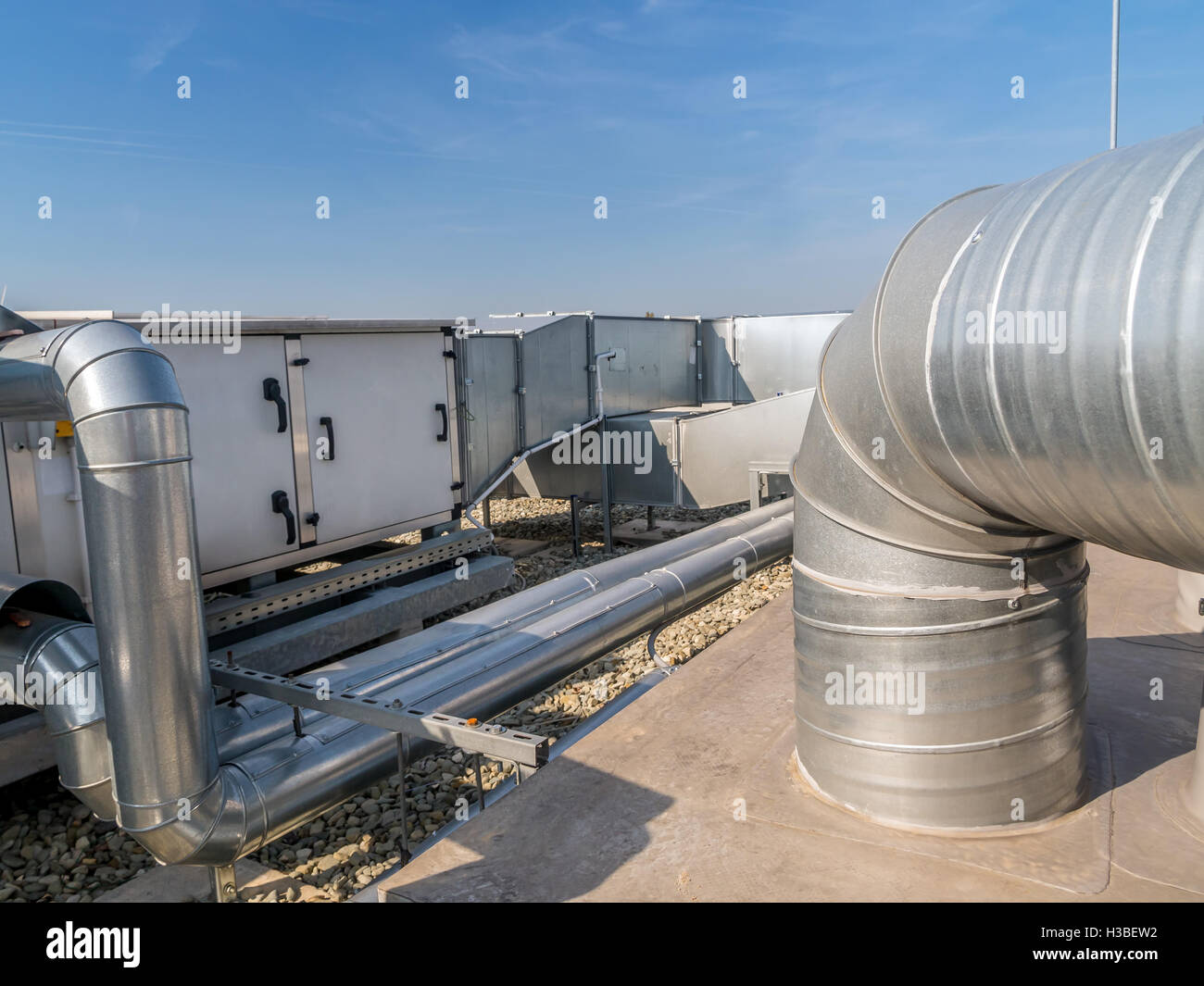 Industrial Air Pipes : Installation of steel air conditioning duct pipes on the