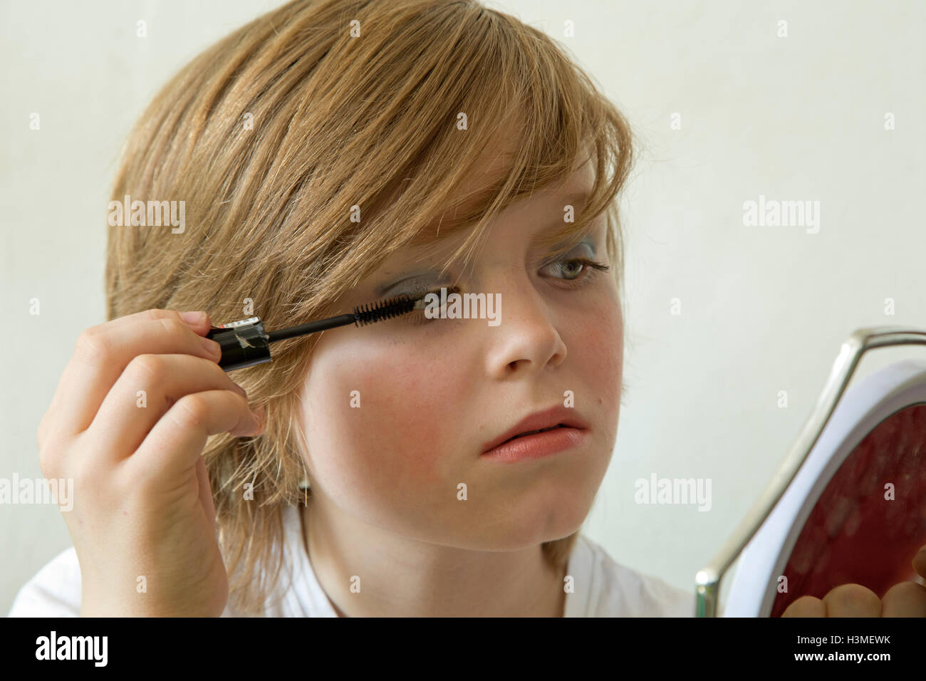 Young Boy Putting Makeup On Pretending To Be A Girl Stock Photo Royalty Free Image 122767279 ...