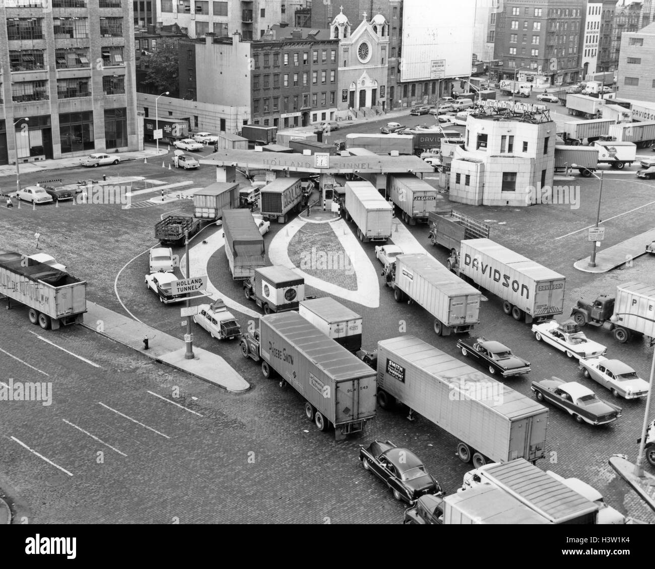1950s OVERHEAD OF TRAFFIC CONGESTION AT ENTRANCE TO