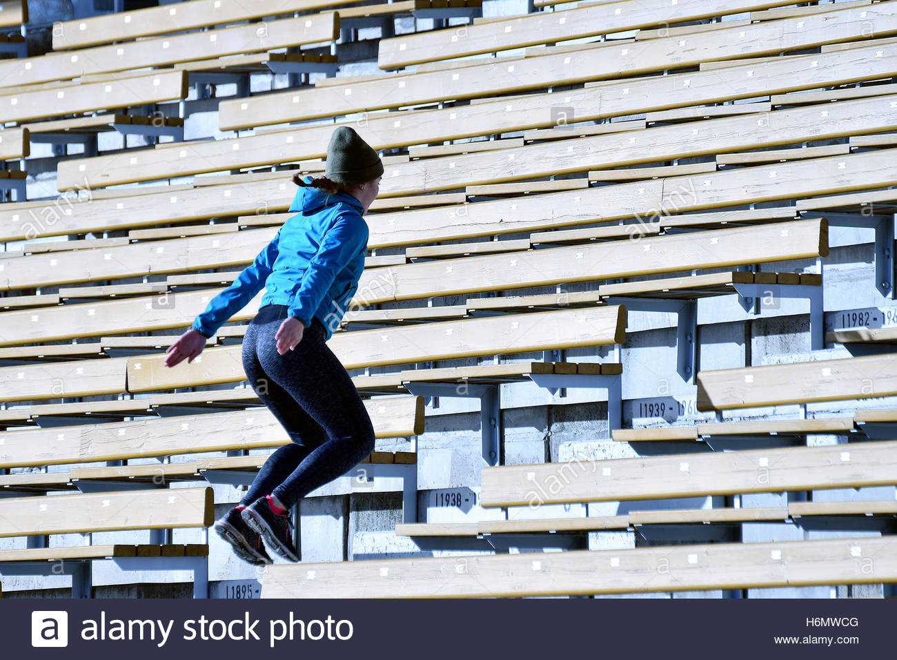Jump. Woman jumping on stairs. Stock Foto