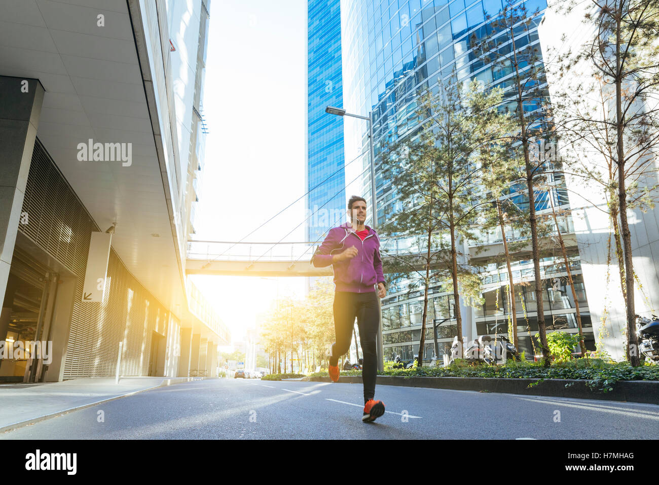 athlete with earphones running in the city Stock Foto