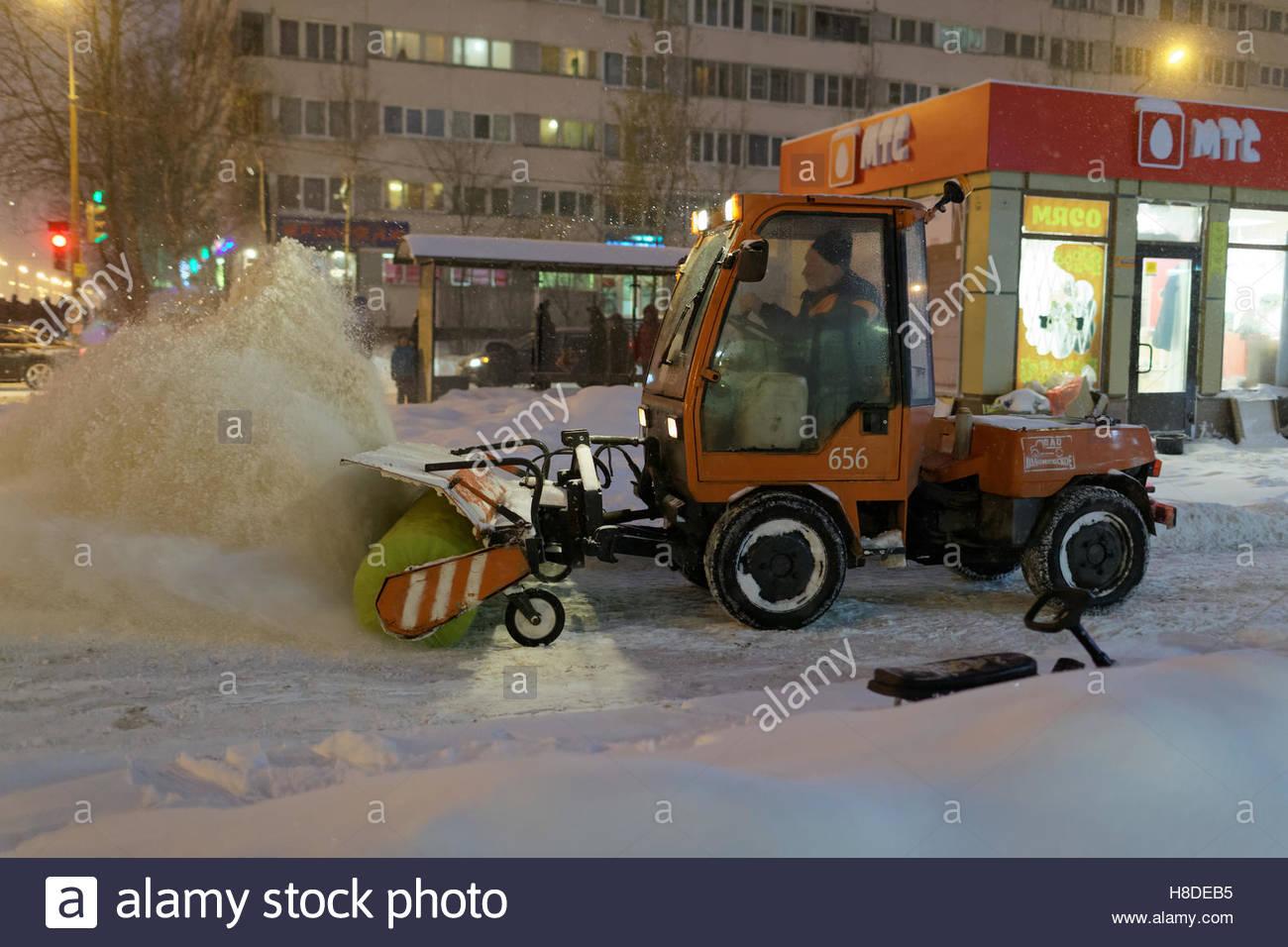 St. Petersburg, Russia, 10th November, 2016. Snowblower at work on Simonova street. More than 20 cm of snow fell Stock Photo