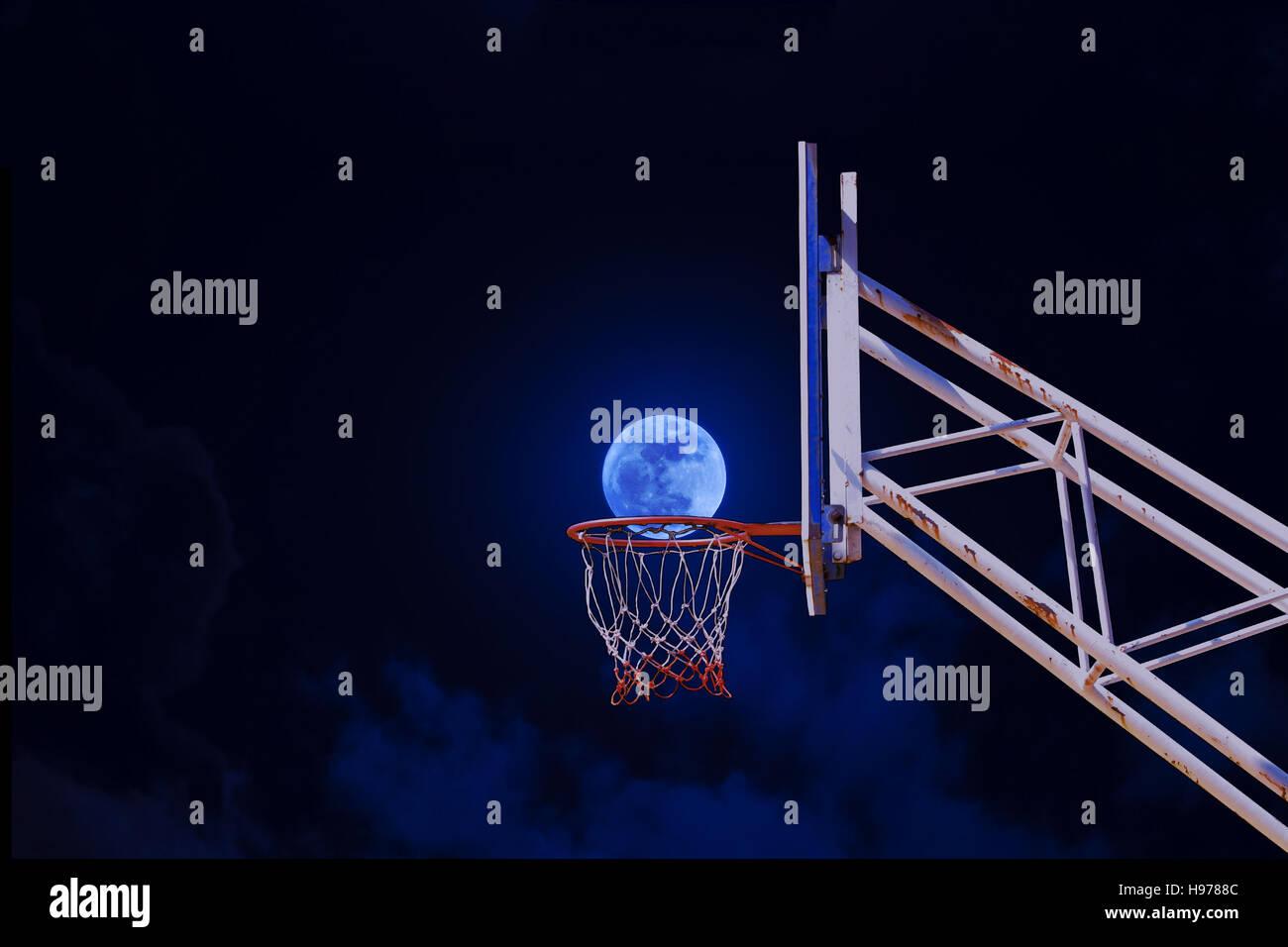 moon in a basketball hoop. Stock Foto