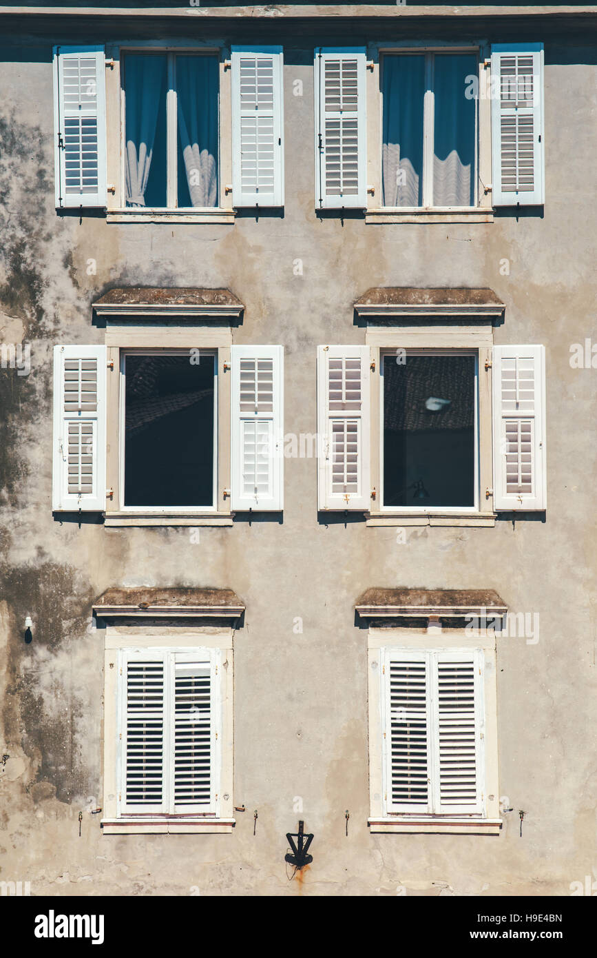 Weathered building facade and old windows with classic for Venetian style home