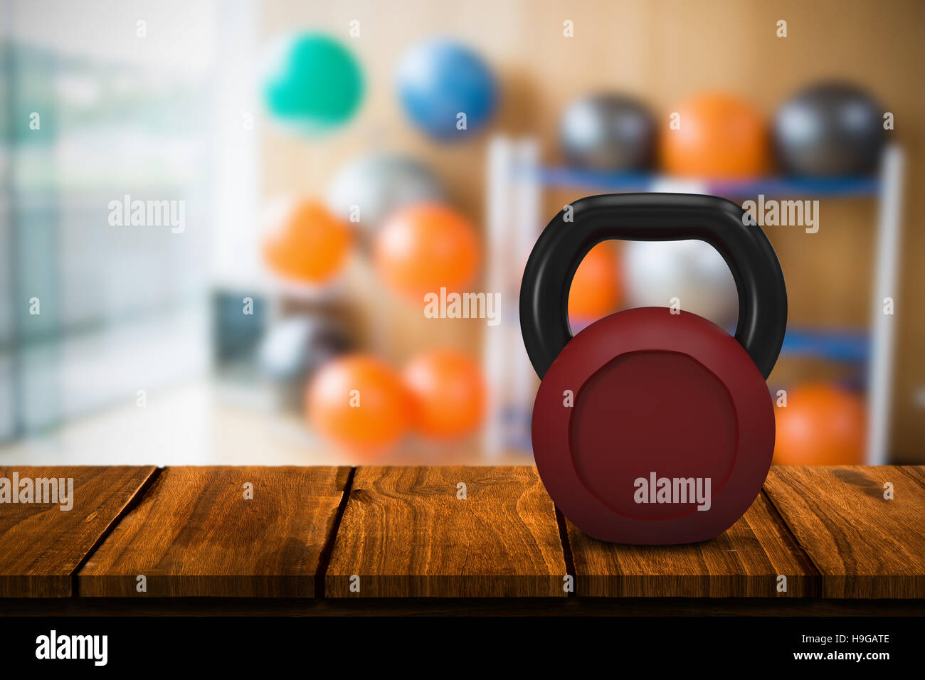 Composite image of red metallic kettlebell Stock Foto