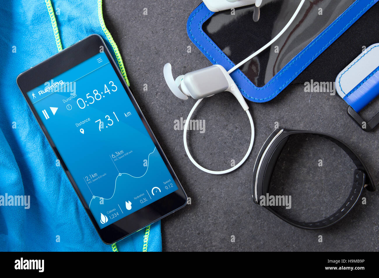 Smartphone with an unknown application for runners on the stone slab. Application was created with graphic program Stock Foto