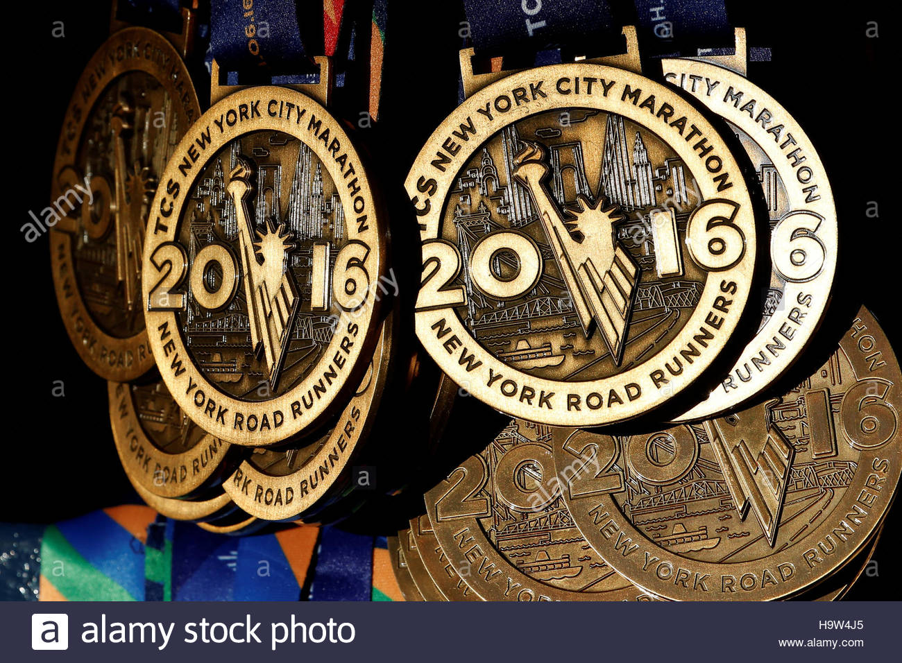 Medals are seen hanging ready for runners near the finish line ahead of the start of the 2016 New York City Marathon Stock Foto