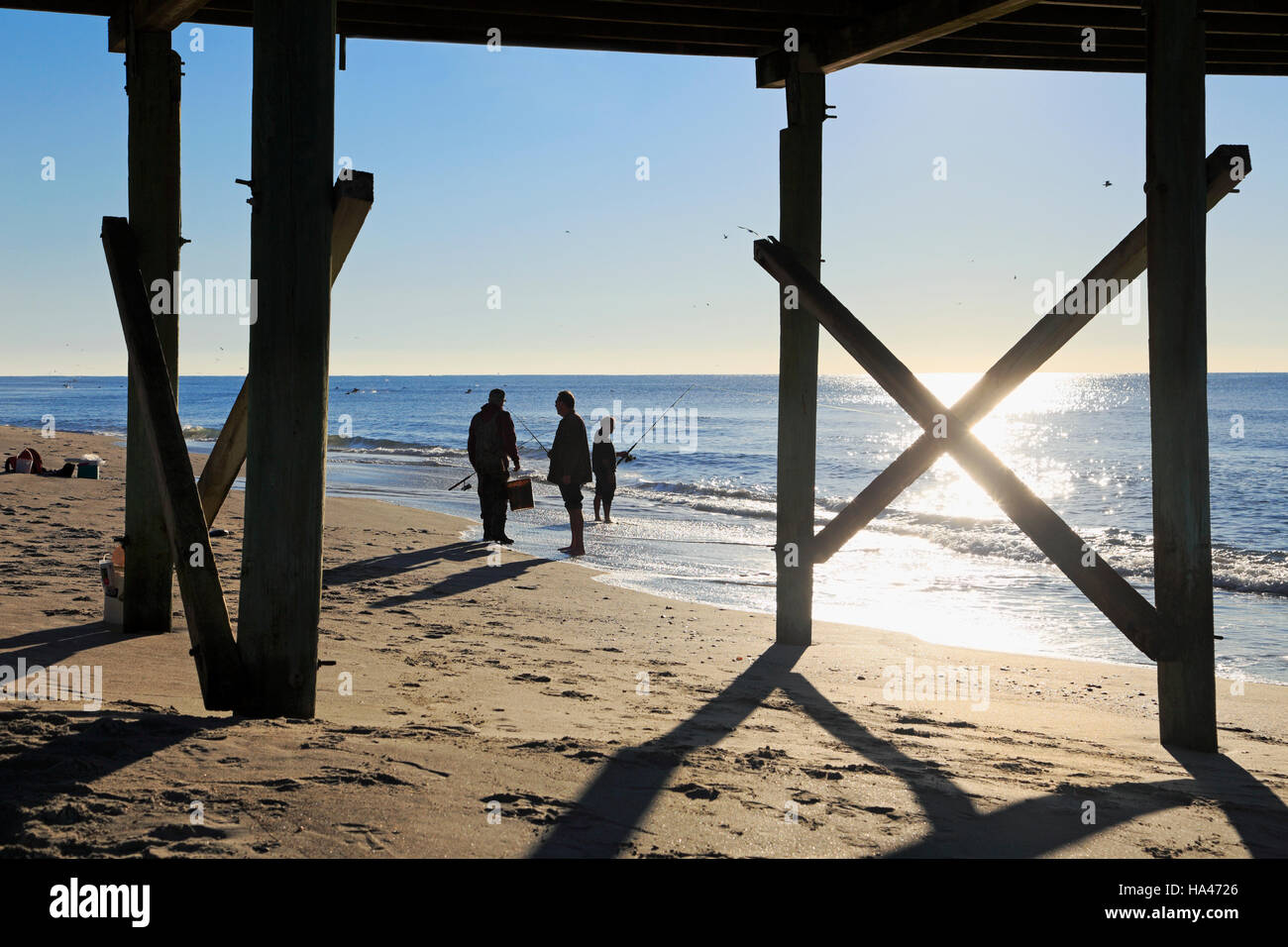 silhouette-of-fishermen-on-the-beach-in-