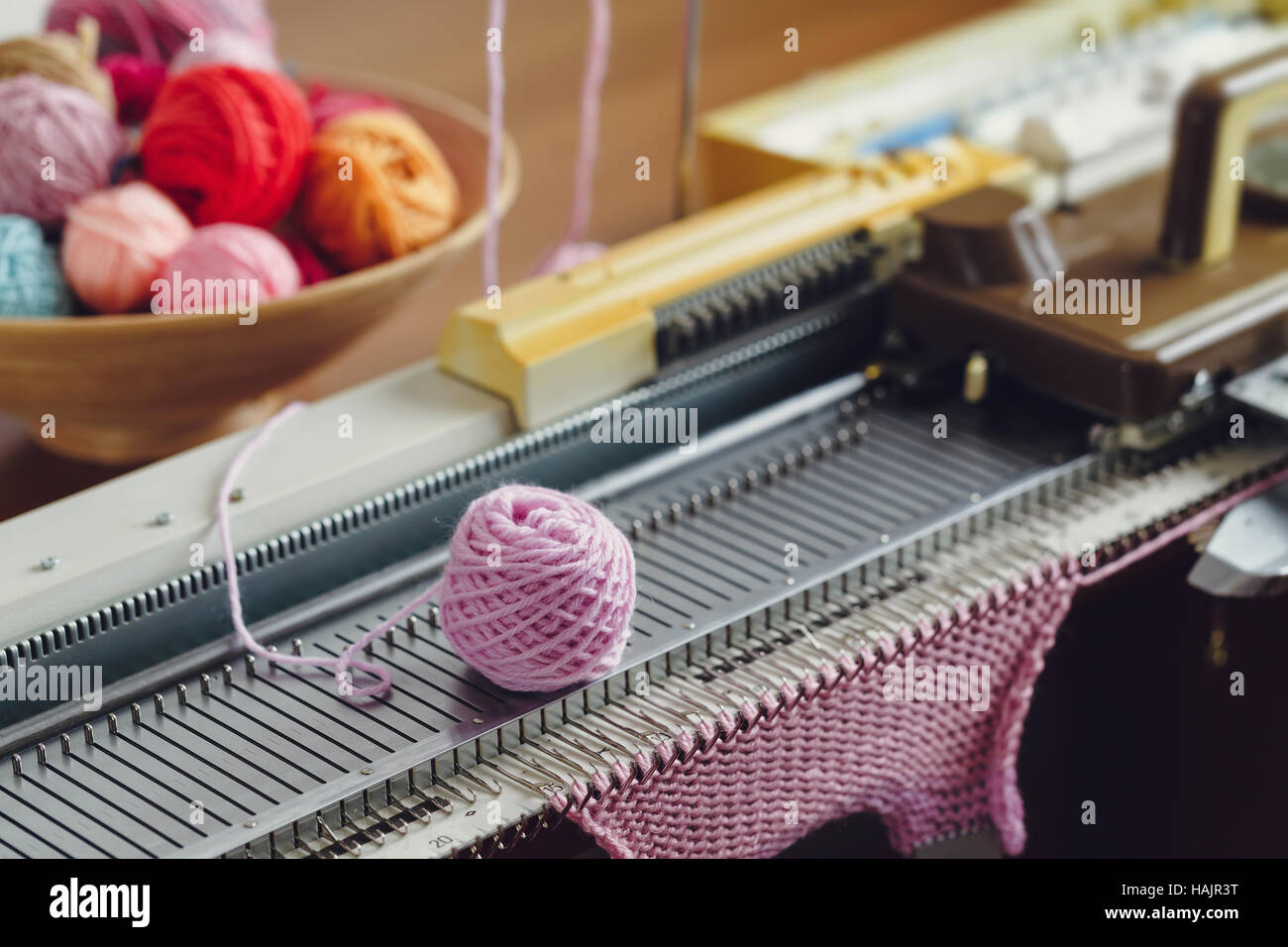 Hand Knitting Machine : Hand knitting machine a is device used