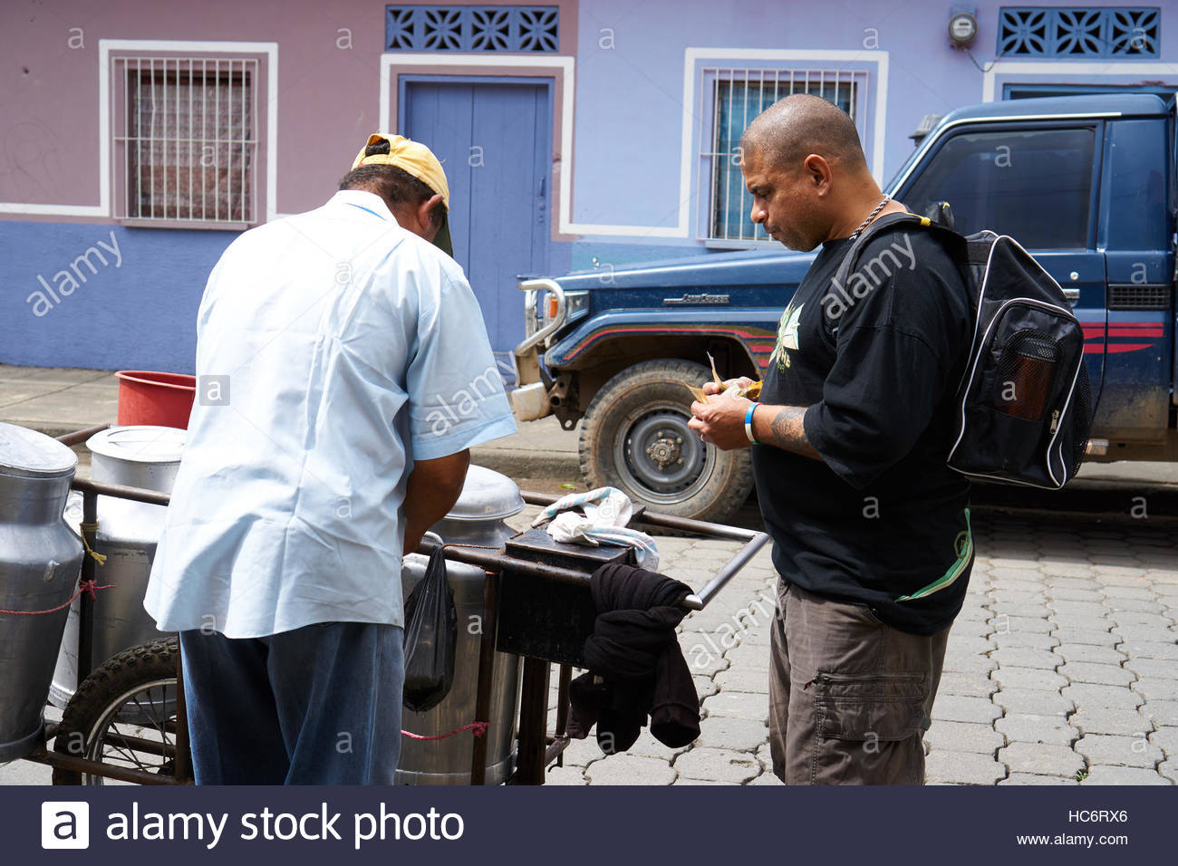 man-buying-milk-from-a-street-vendor-wit