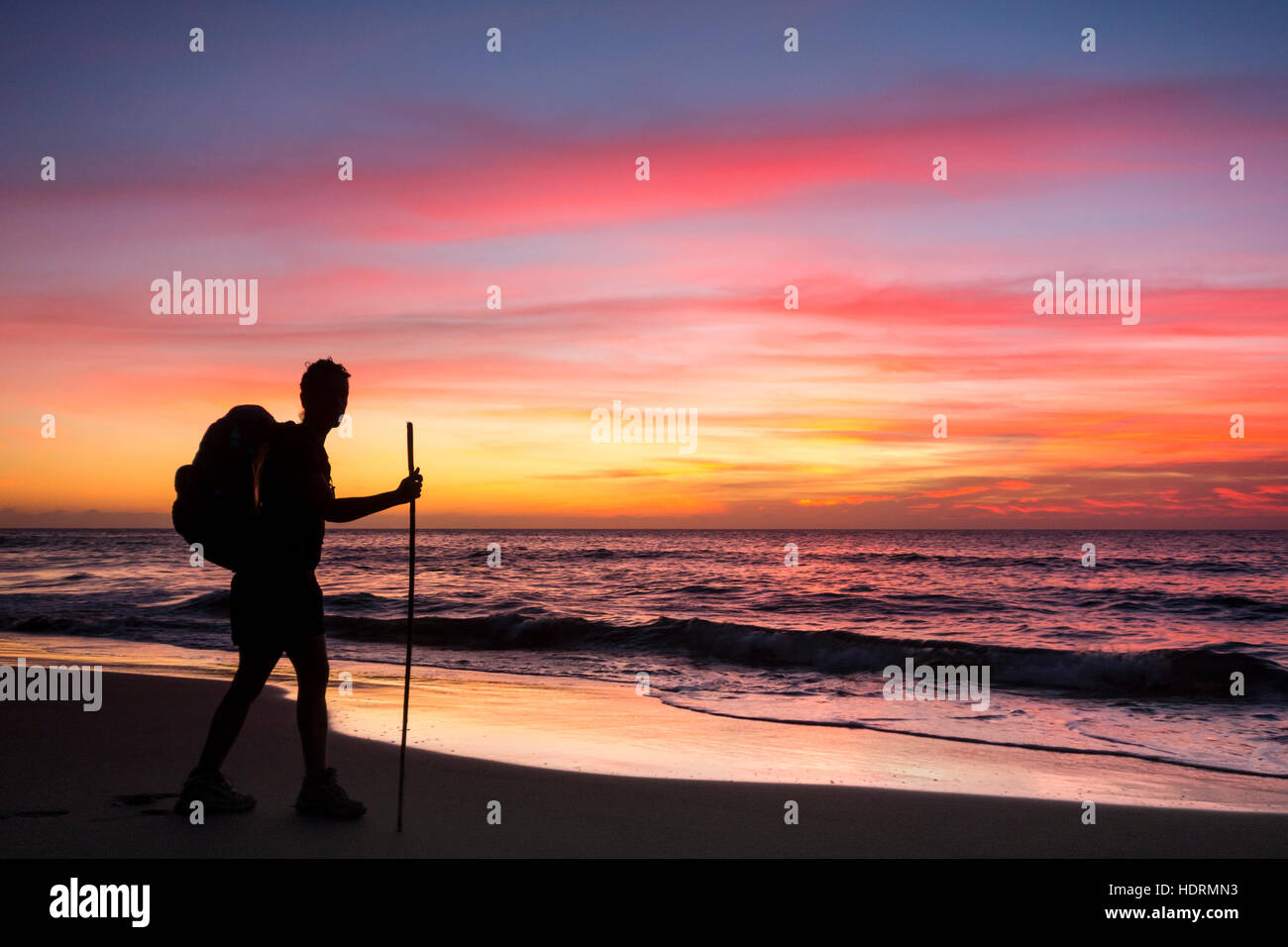 Hiker on remote Guigui (or Guyguy) beach on the west coast of Gran Canaria at sunset Stock Foto