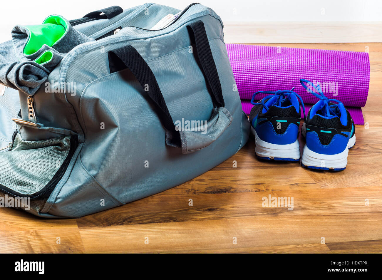Sport bag on the wooden floor Stock Foto