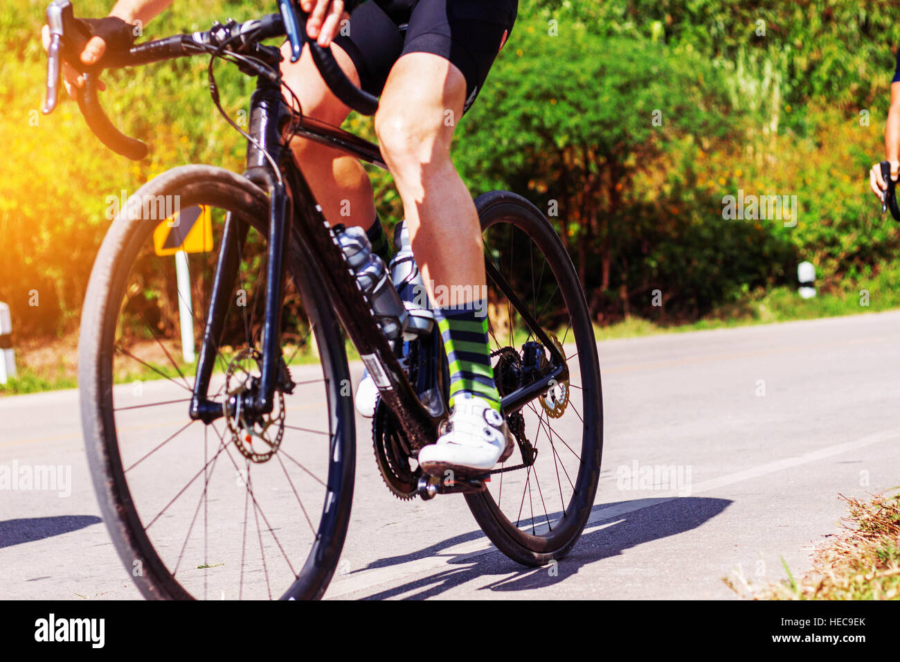 young man was cycling on the road in the morning. Stock Foto