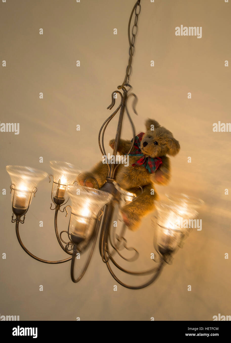 teddy-bear-wearing-a-christmas-bow-swing