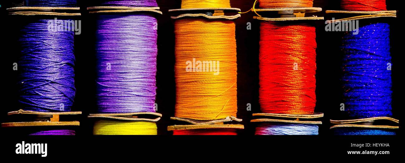a colourful row of cotton reels Stock Photo