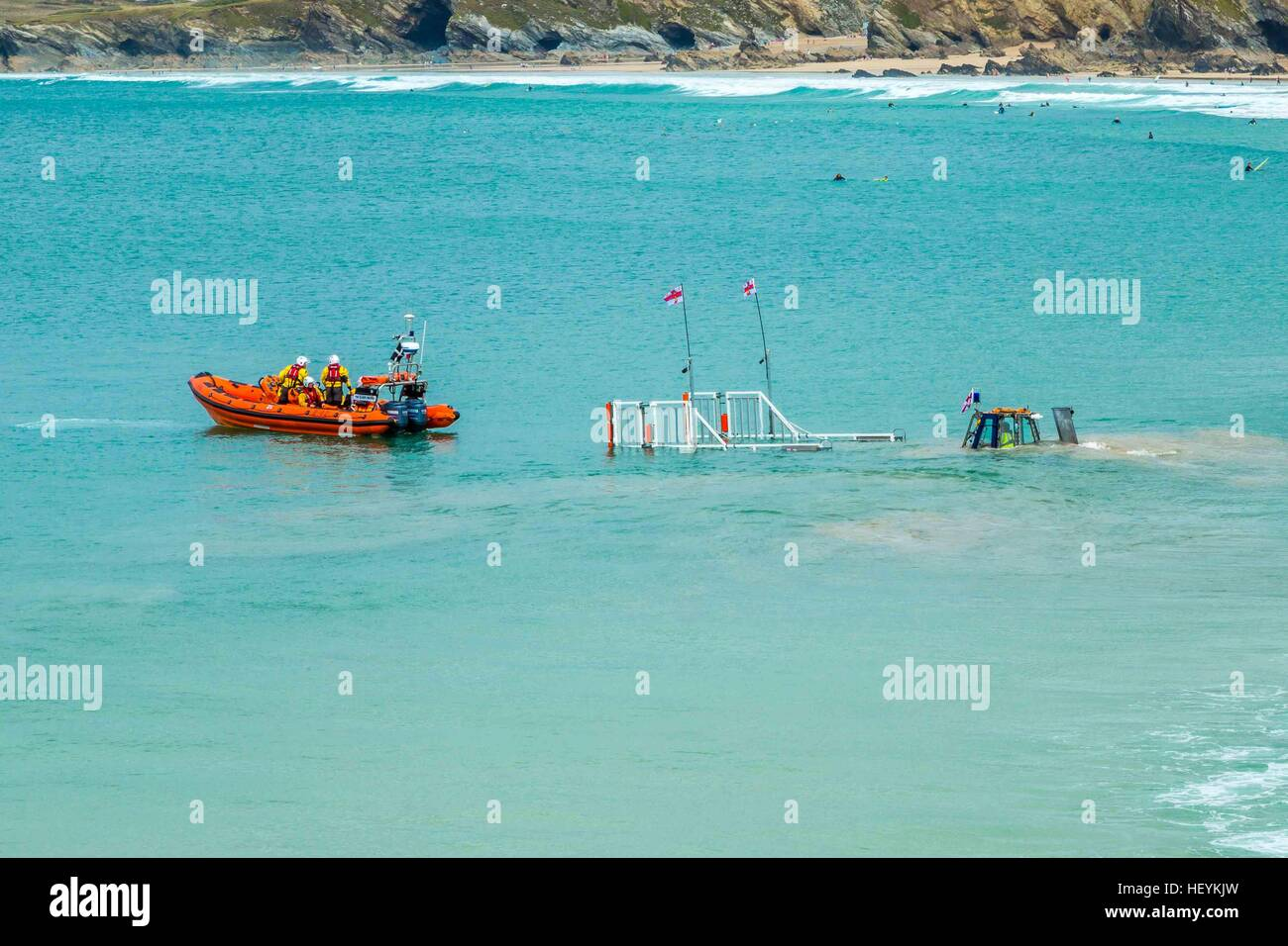 The Newquay RNLI life boat returning to the harbour in Cornwall on it;'s cradle Stock Photo