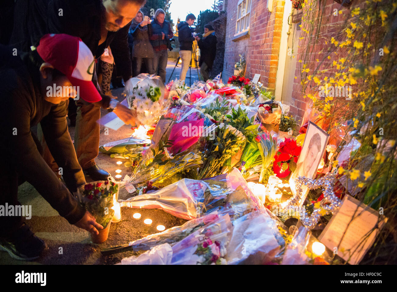 Goring, UK. 26th Dec, 21016.  Flowers, candles and words of sympathy were left outside George Michael's home in Stock Photo