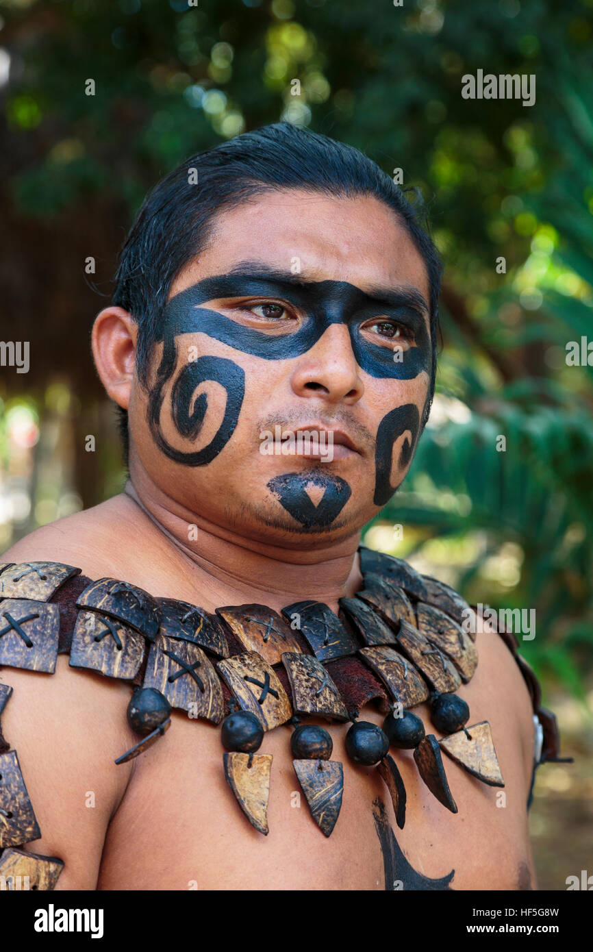Local mayan male dressed in the traditional face paint and for African body decoration