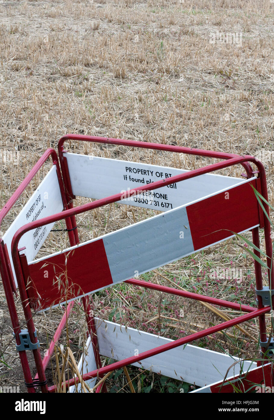 BT barrier around a forgotten hole in a field Stock Photo
