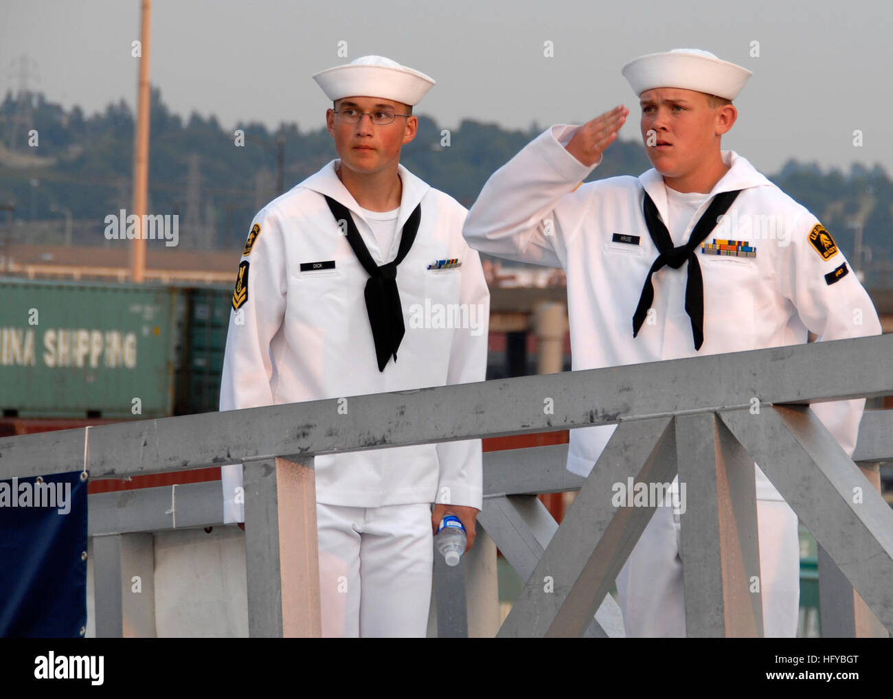 100805-N-9761H-133 SEATTLE (Aug. 5, 2010) A Sea Cadet salutes the national ensign from the brow of the amphibious Stock Photo