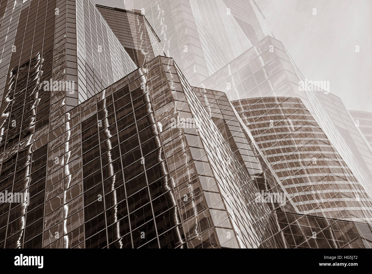 Abstract view of glass skyscrapers reflecting nearby buildings Stock Photo