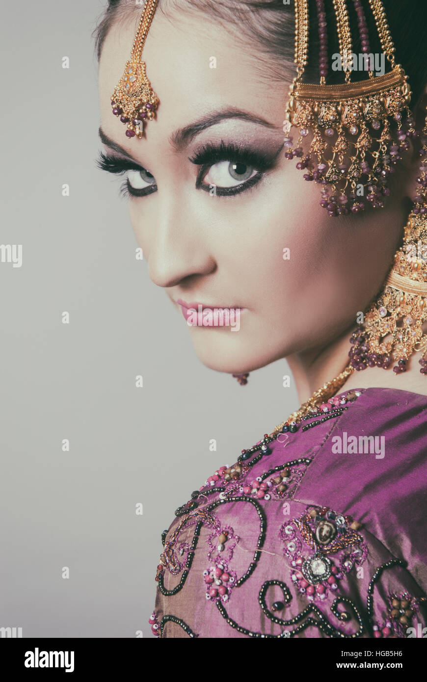 Serious Asian bride looking over shoulder Stock Foto