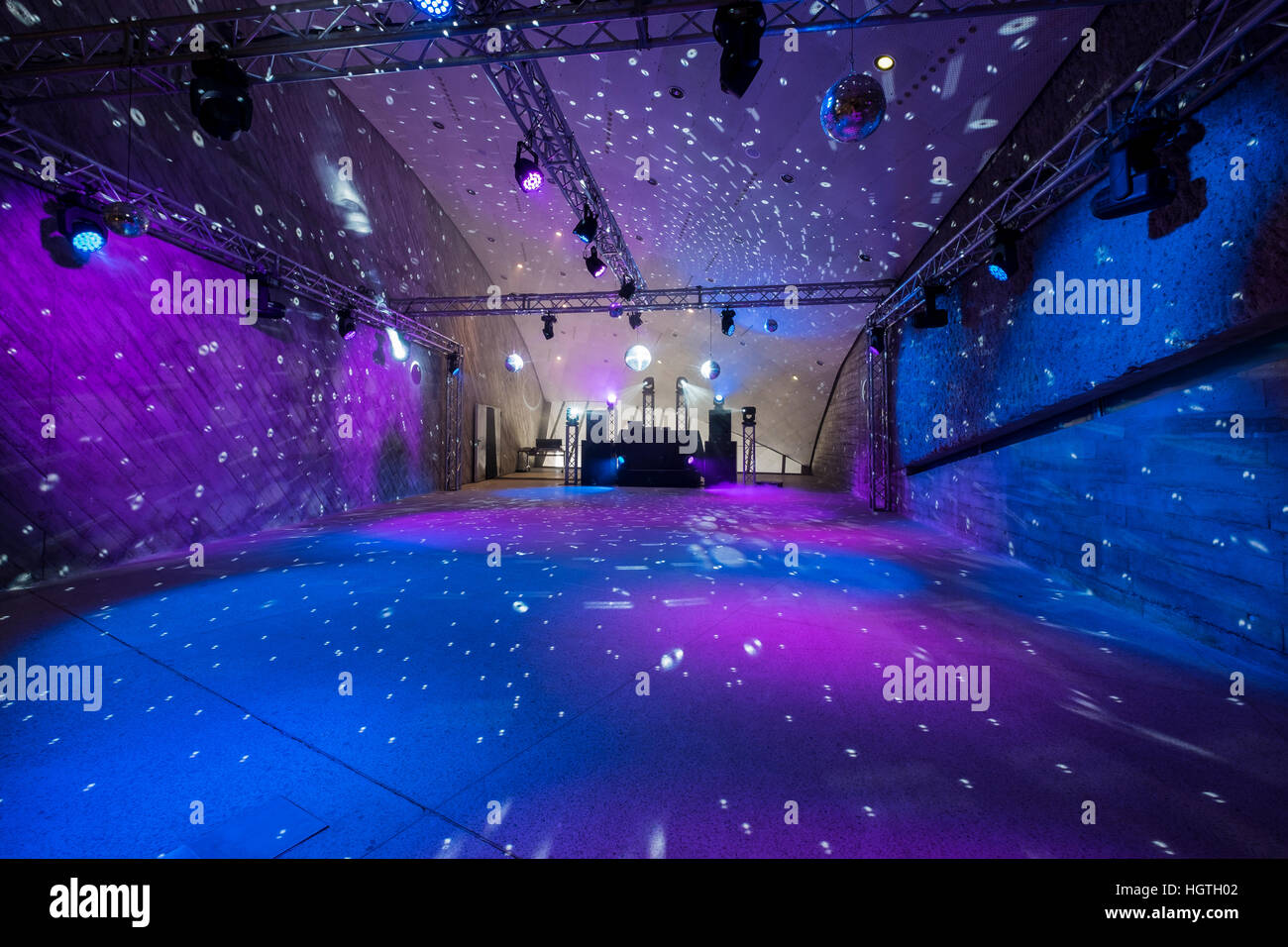 Empty disco dance floor with led lighting and mirror balls ...