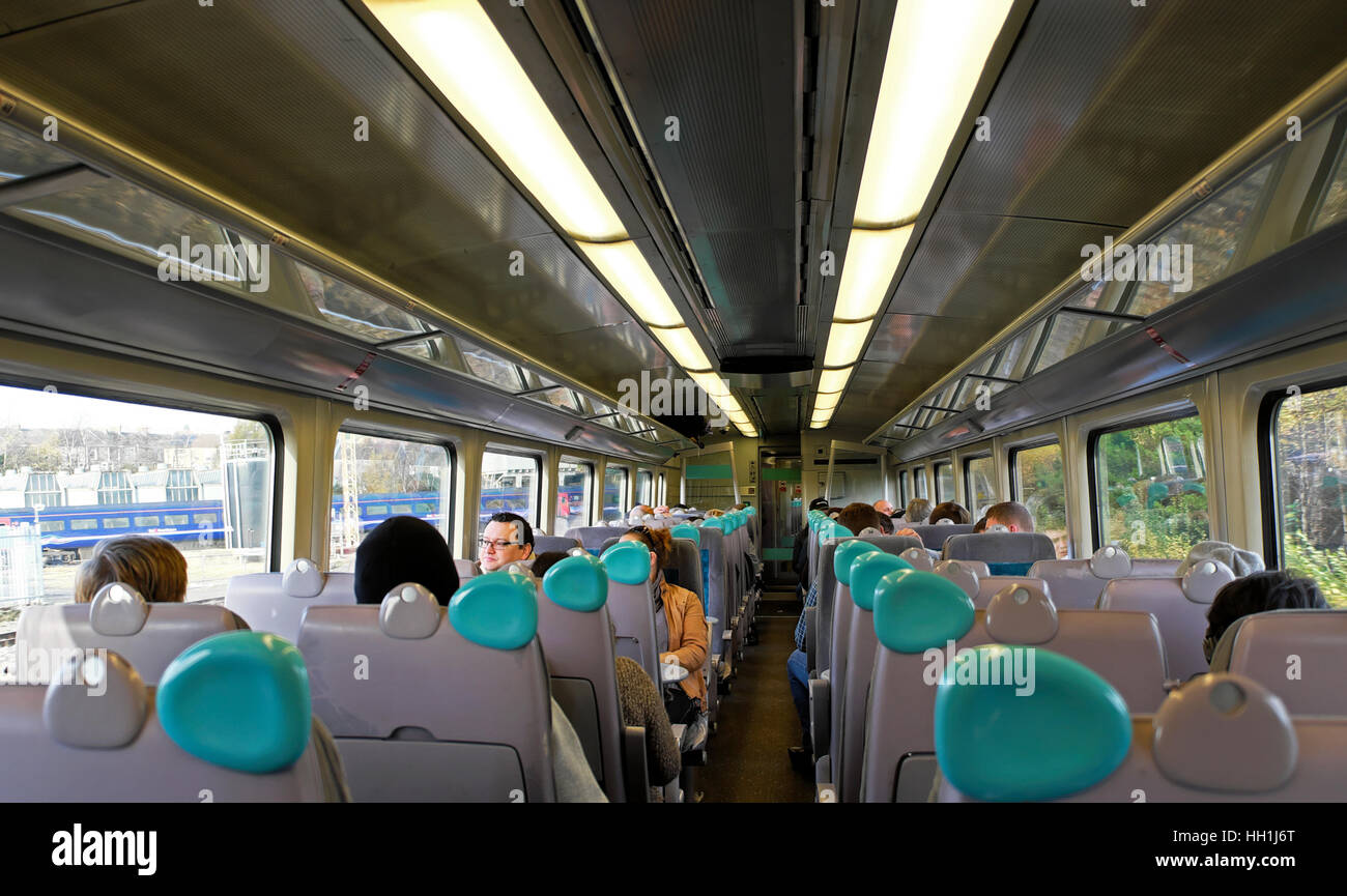 passengers sitting in a train carriage interior traveling between stock photo royalty free. Black Bedroom Furniture Sets. Home Design Ideas