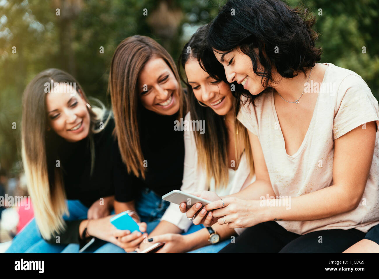 Big Group of friends using cellphones in the street. Stock Photo