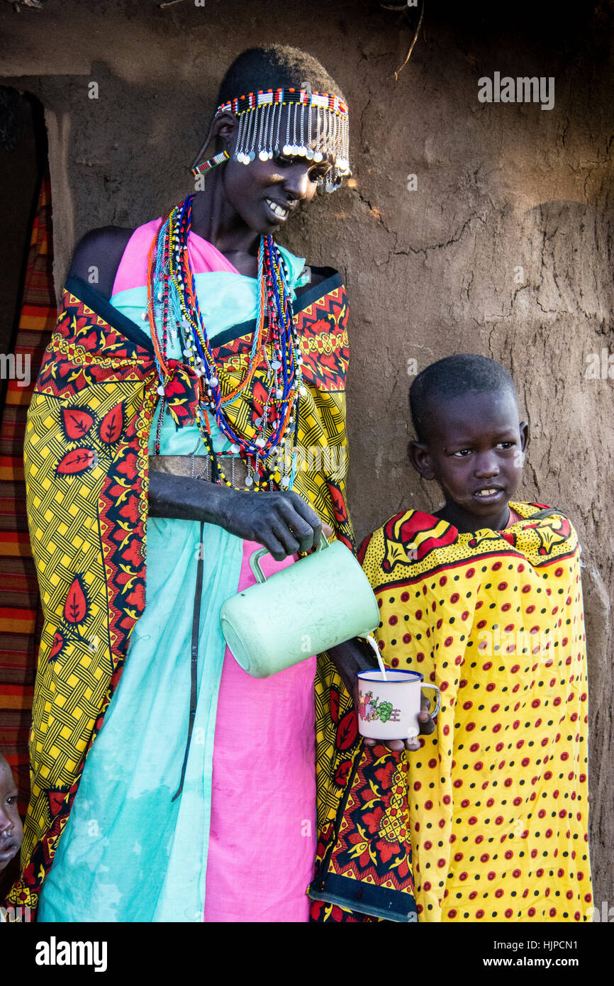 maasai-woman-pouring-milk-for-a-child-we