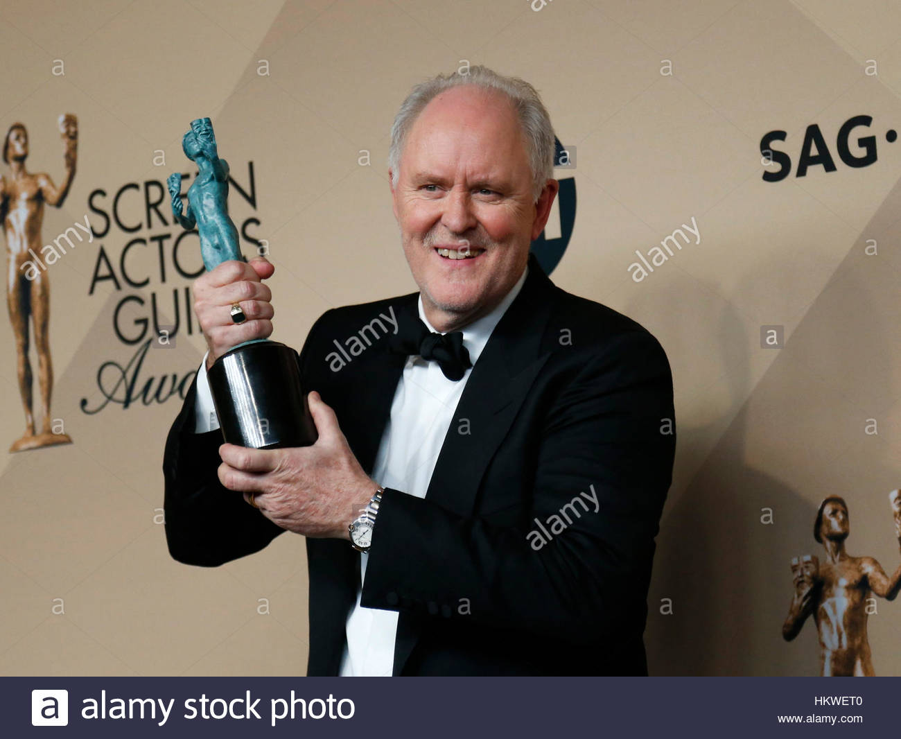 John Lithgow poses with the award he won for Outstanding Performance by a Male Actor in a Drama Series for his role Stock Foto