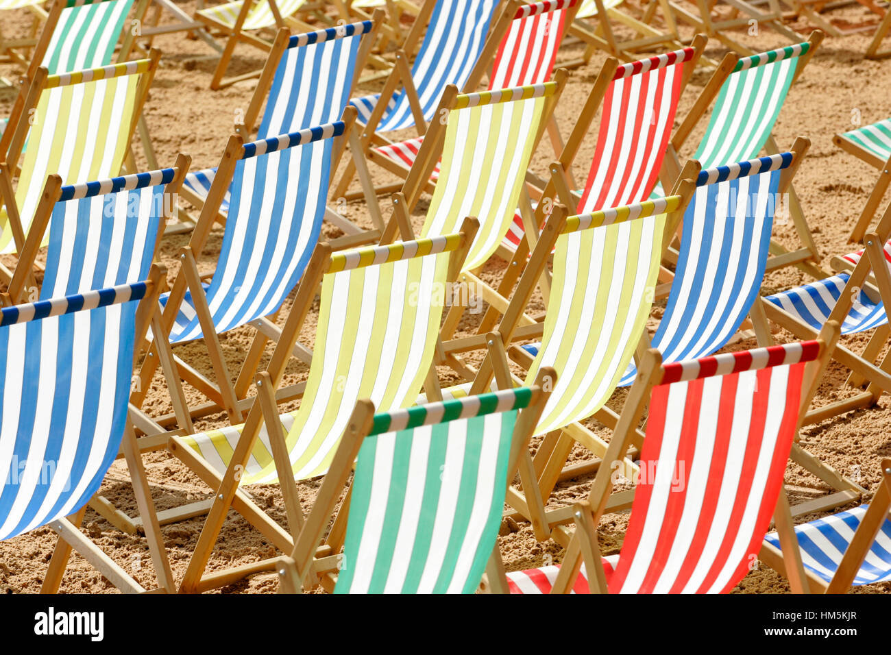 rows-of-empty-deckchairs-in-redyellowgre