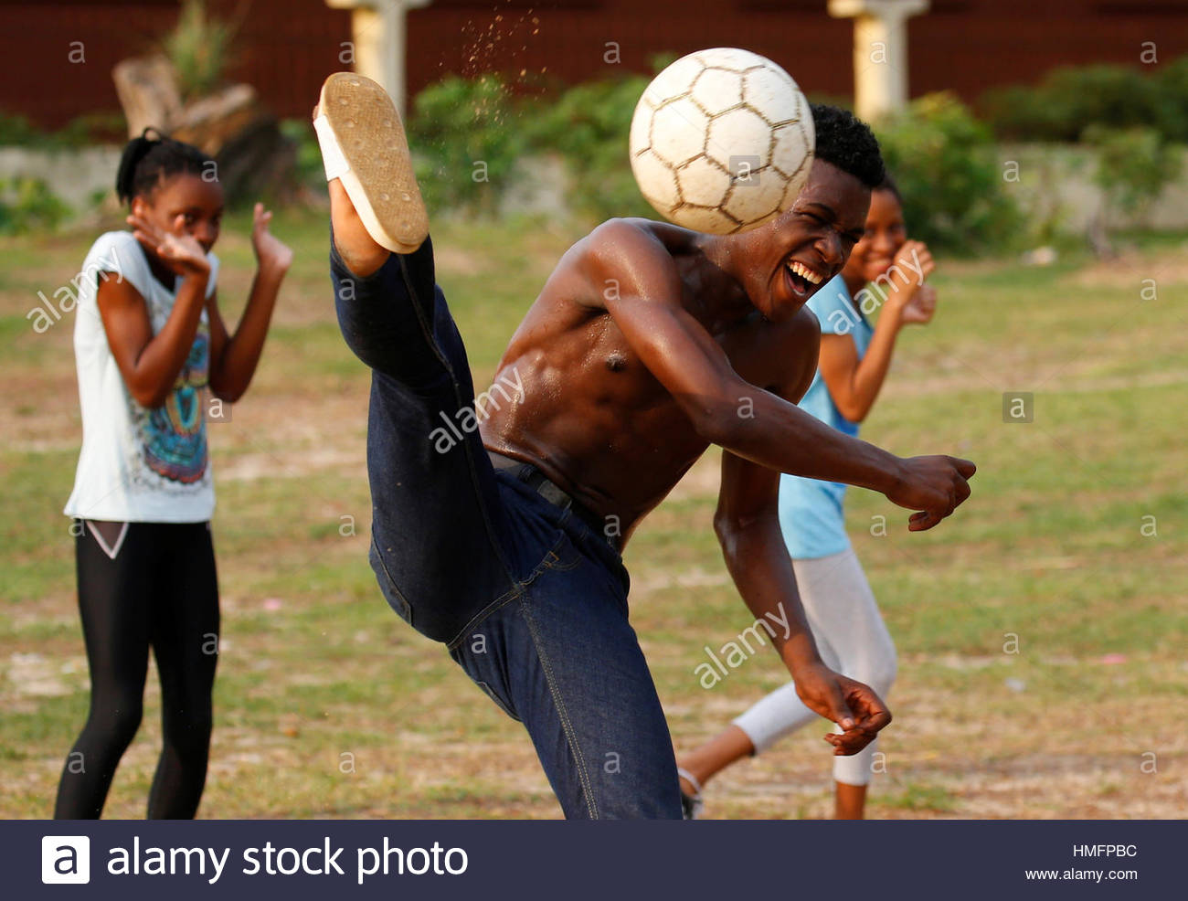 Youths practice their soccer skills at a park ahead of the African Nations Cup soccer final in Libreville, Gabon, Stock Foto