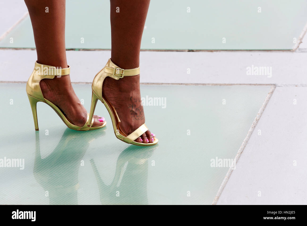 Legs Of Beautiful African American Woman In Golden High