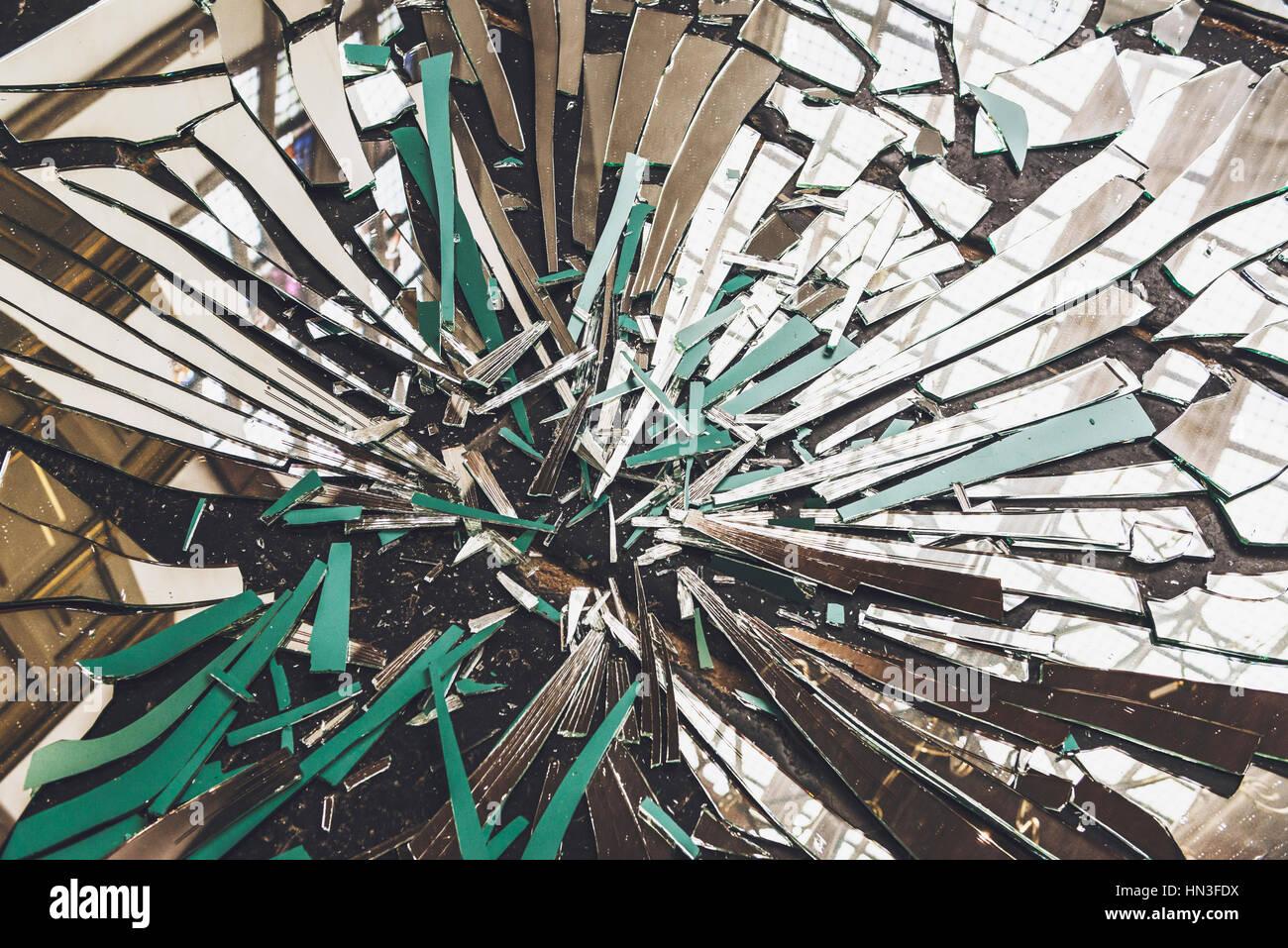 Close Up View Of Broken Mirror On Floor With Window Light