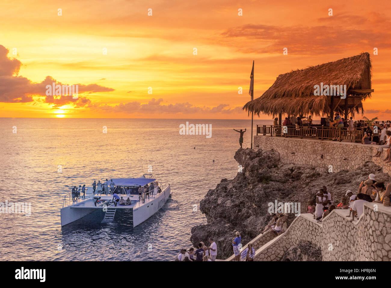 Ricks Cafe open air bar , Rick´s viewpoint at sunset, Catamaran, nightlife, Negril Jamaica, Stock Photo