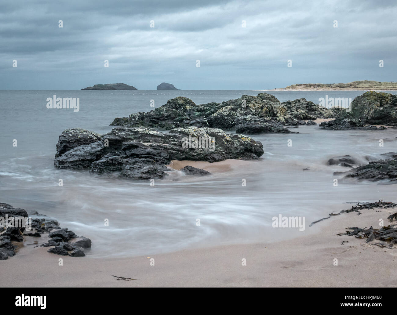 moody-beach-with-swirling-waves-in-firth
