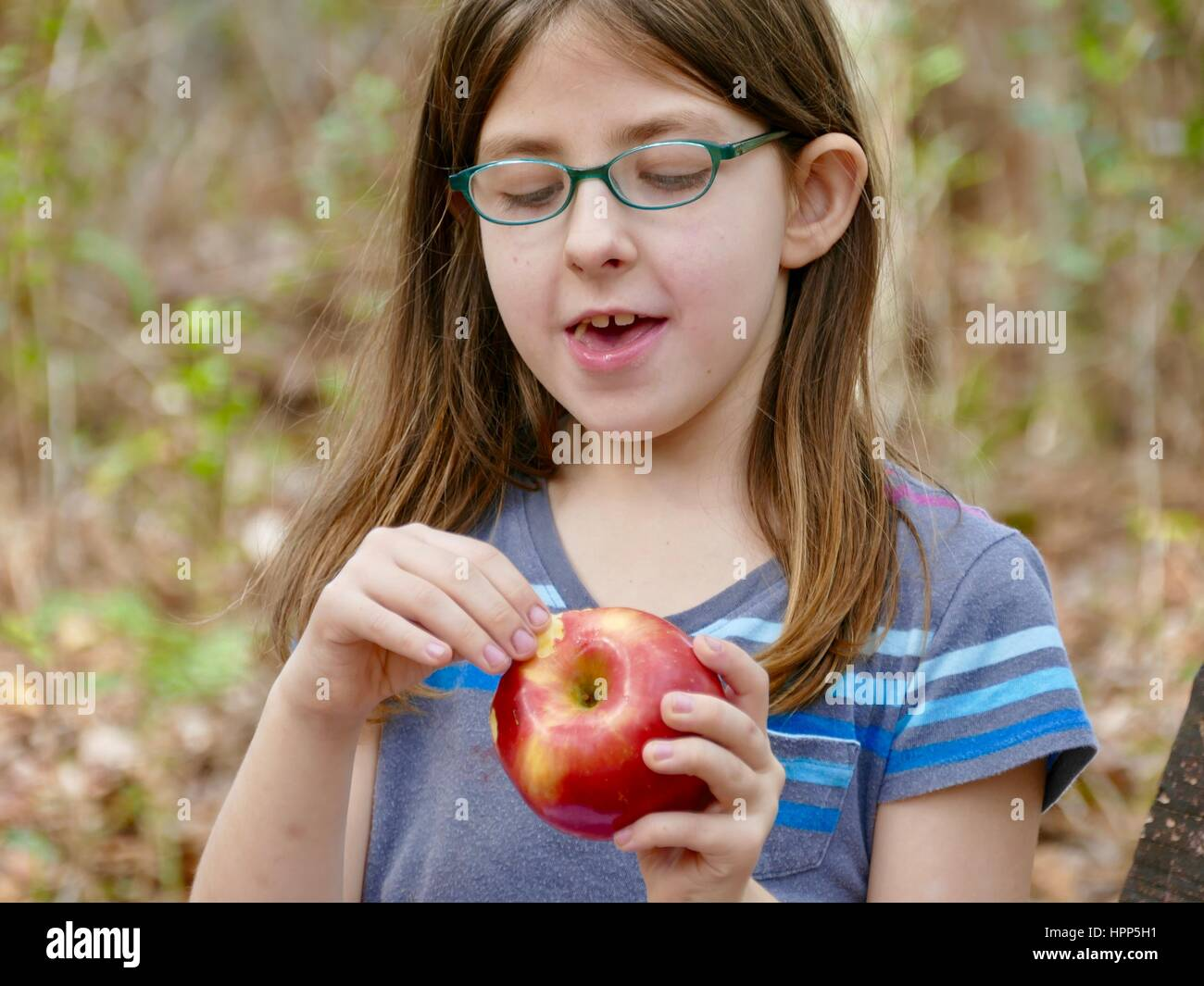 young-girl-with-green-eyeglasses-eating-