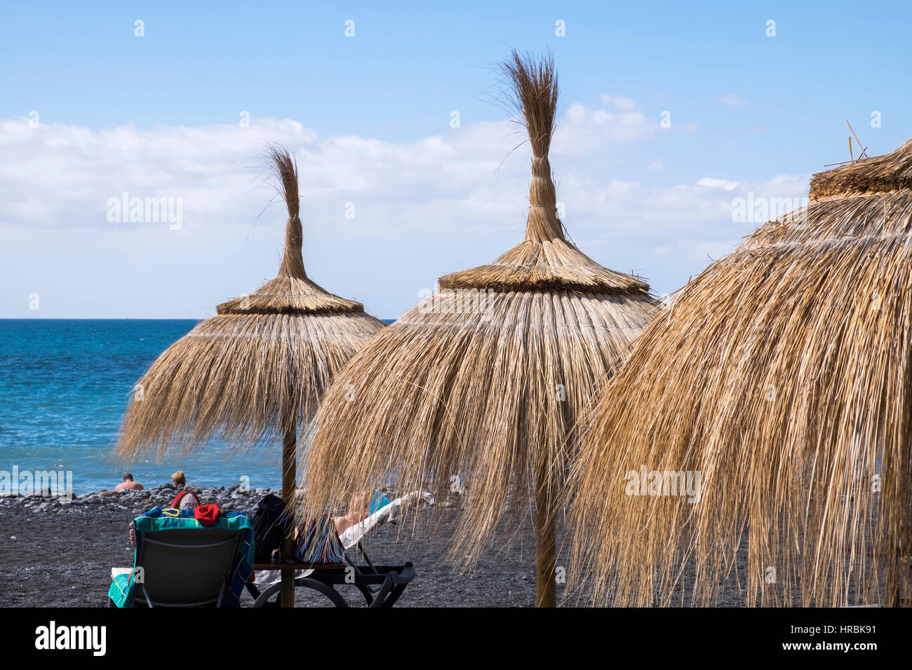 straw-sunshade-umbrellas-on-the-beach-of