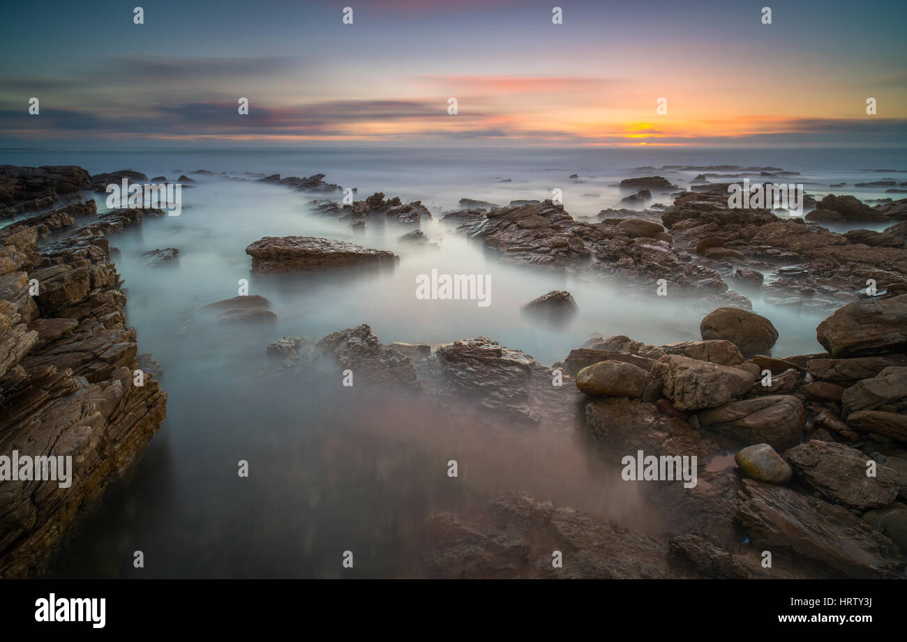 Rocky beach sunset Stock Photo