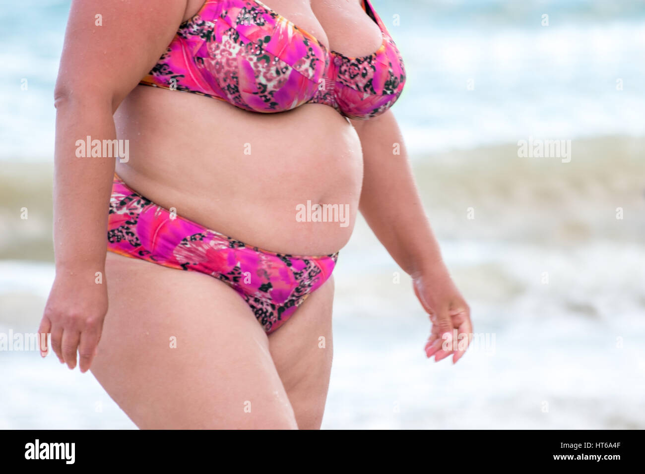 obese woman in a swimsuit lady with fat belly negative. Black Bedroom Furniture Sets. Home Design Ideas