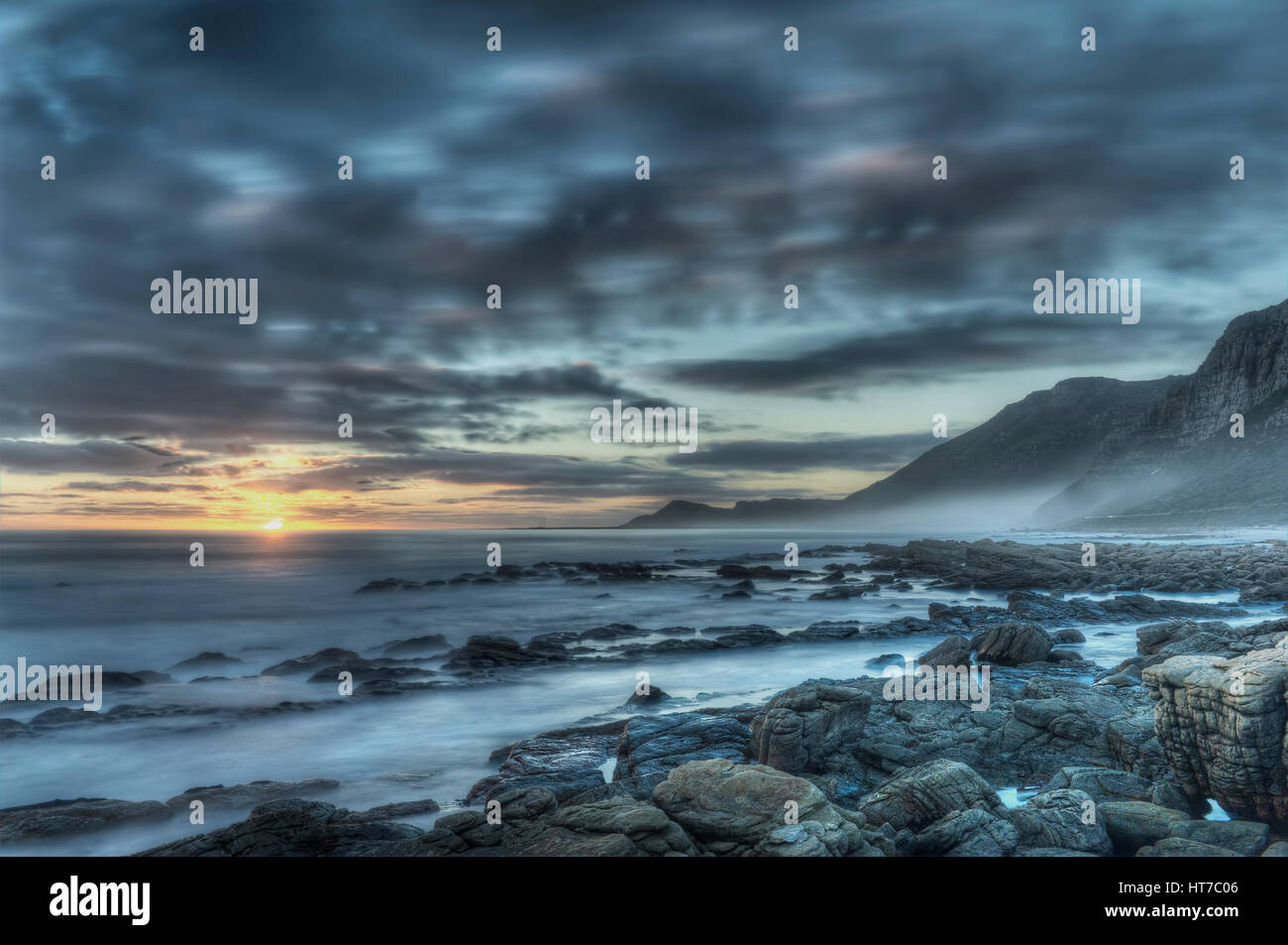 Sunset rocky ocean Stock Photo