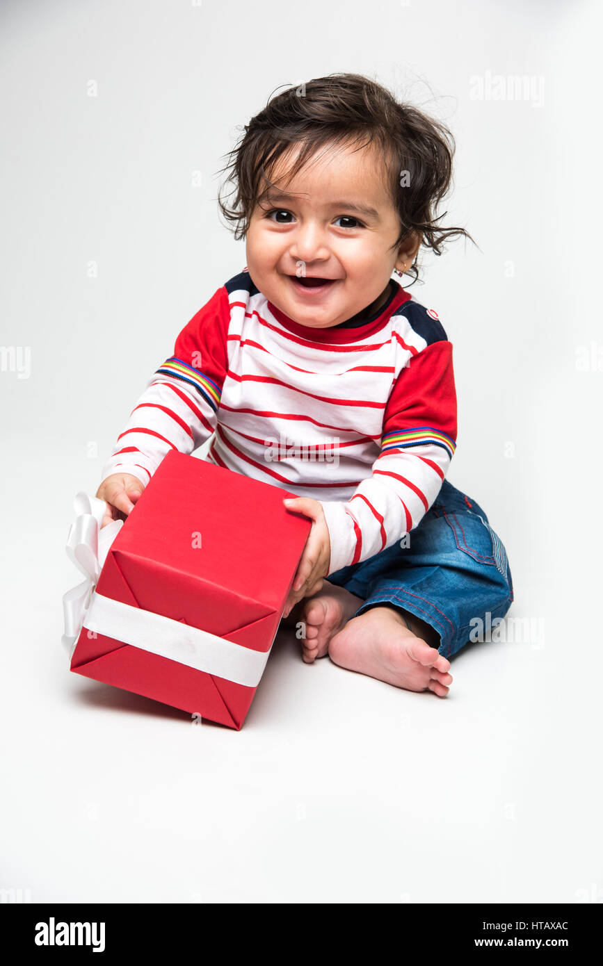 Indian baby boy playing over over white background and looking at camera Stock Photo