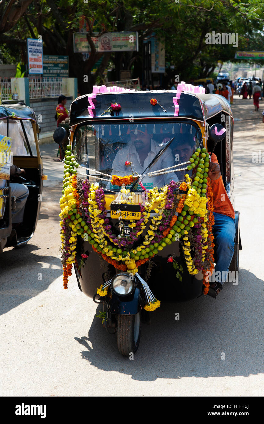 tuk tuk the common taxi in india decorated with flowers chitradurga stock photo royalty free. Black Bedroom Furniture Sets. Home Design Ideas