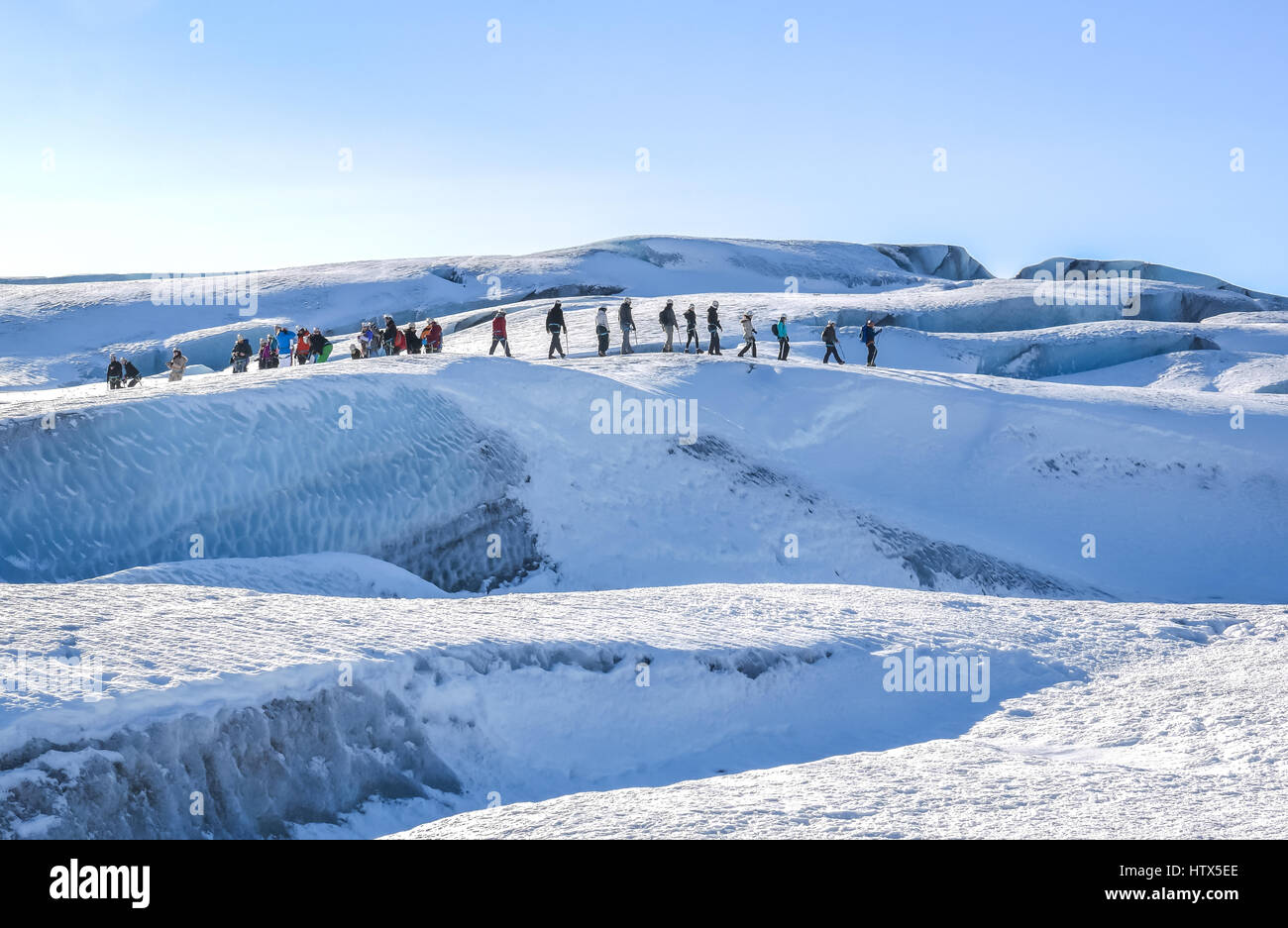 line-of-people-being-led-on-glacier-walk