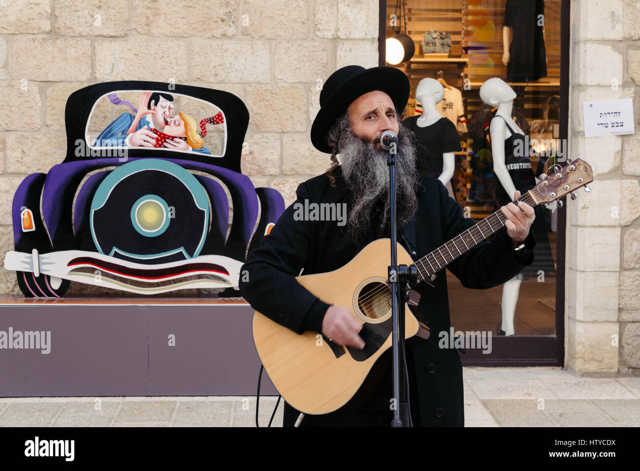 Middle East Israel Jerusalem mehane Yehuda market a Jewish man entertains shoppers with his guitar Stock Photo