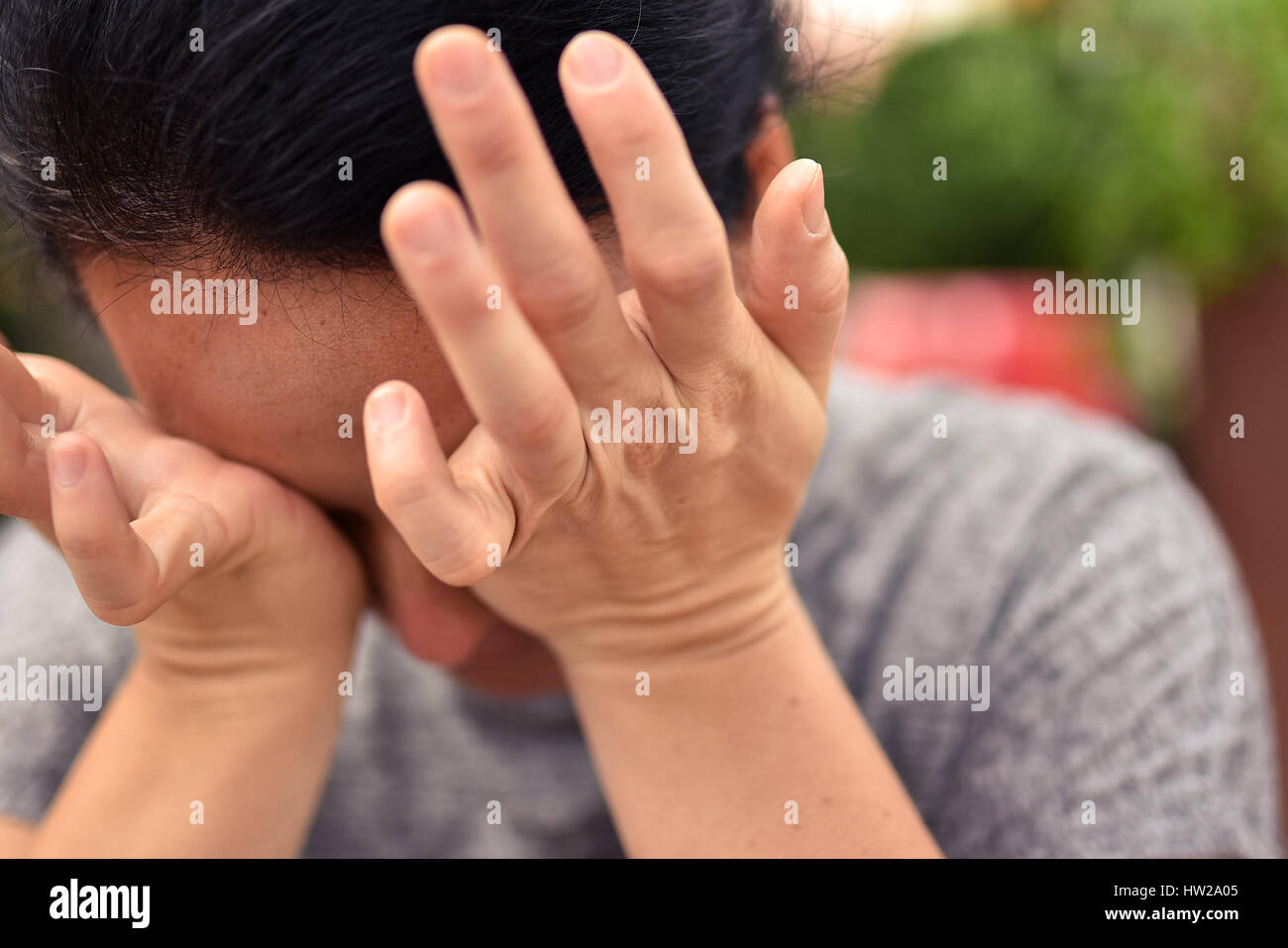 young-attractive-woman-hiding-her-face-i
