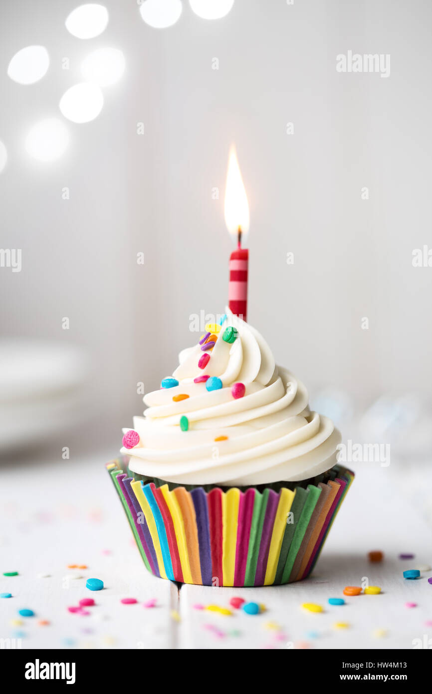 Birthday Cupcake With A Single Red Candle Stock Photo