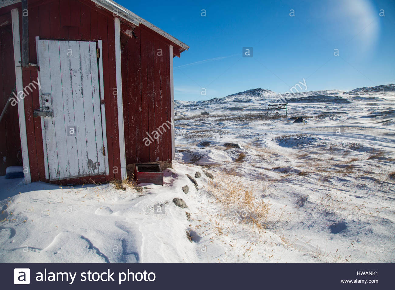 red greenlandic home frozen landscape daylight Stock Photo